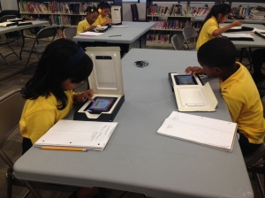 Uplift Hampton scholars work on tablets.