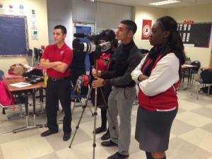 Uplift Peak students film the morning announcement.
