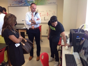 Uplift IT specialist John Ravago demonstrates how the 3-D printer works for Leadership Dallas participants.