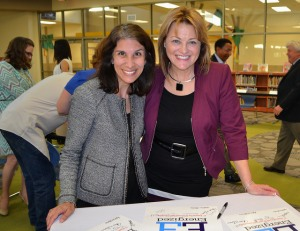 Uplift CEO Yasmin Bhatia and GPISD Superintendent Dr. Susan Hull sign documents to formalize the partnership.